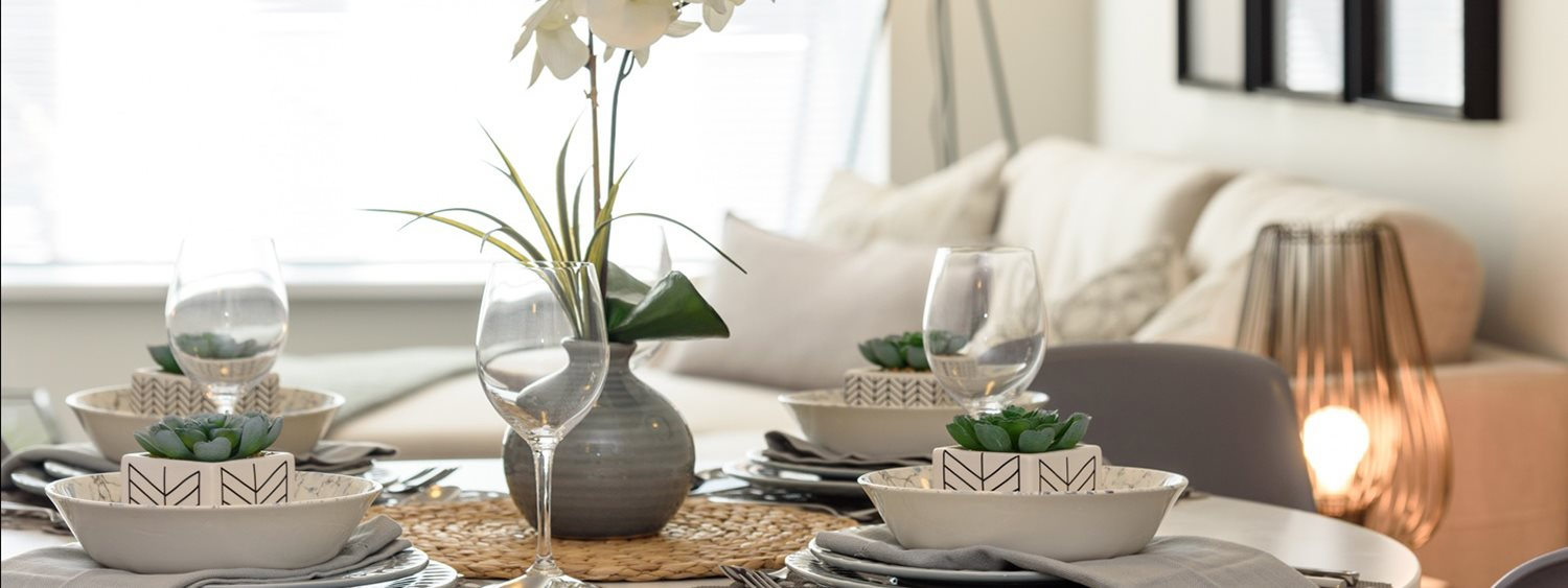 Set table with white flower centerpiece