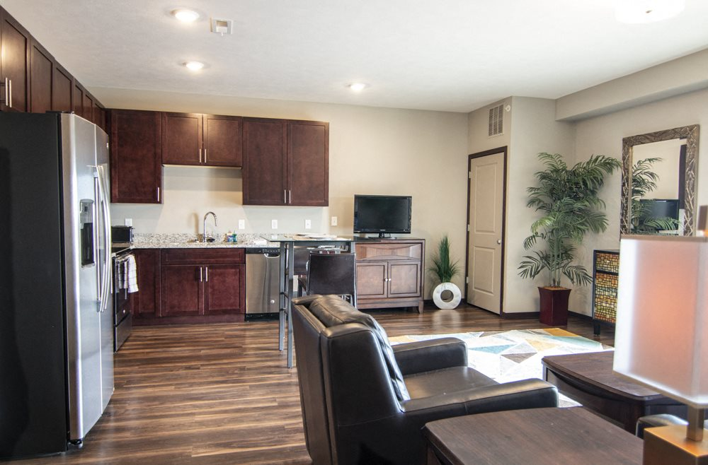 Open layout with living room and kitchen with stainless steel appliances at 360 at Jordan West best new apartments West Des Moines IA 50266