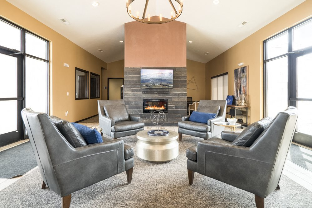 Clubhouse lounge with seating at 360 at Jordan West best new apartments West Des Moines IA 50266
