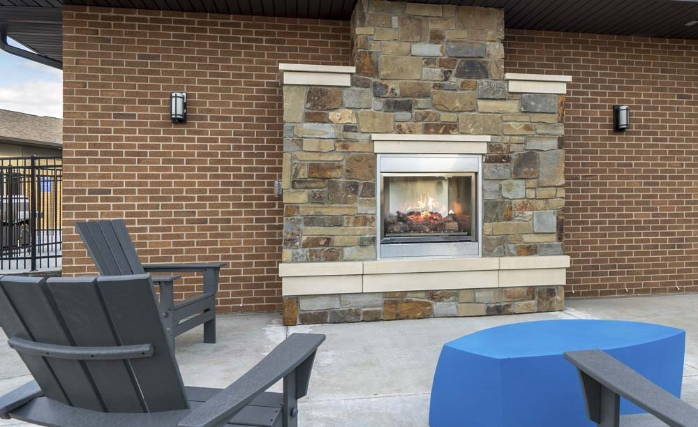 Outdoor fireplace and social lounge at 360 at Jordan West best new apartments West Des Moines IA 50266
