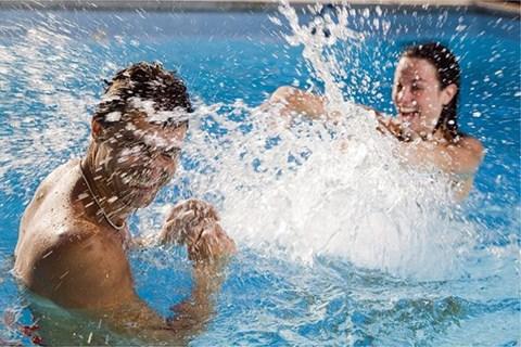 Splashing in Pool l Davinci Apartments