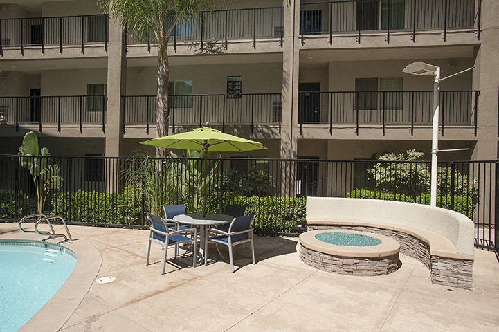 Pool with lounge chairs  l Davinci Apartments