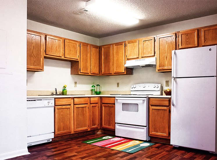 Kitchen with all white appliances including: dishwasher, oven, and refrigerator.