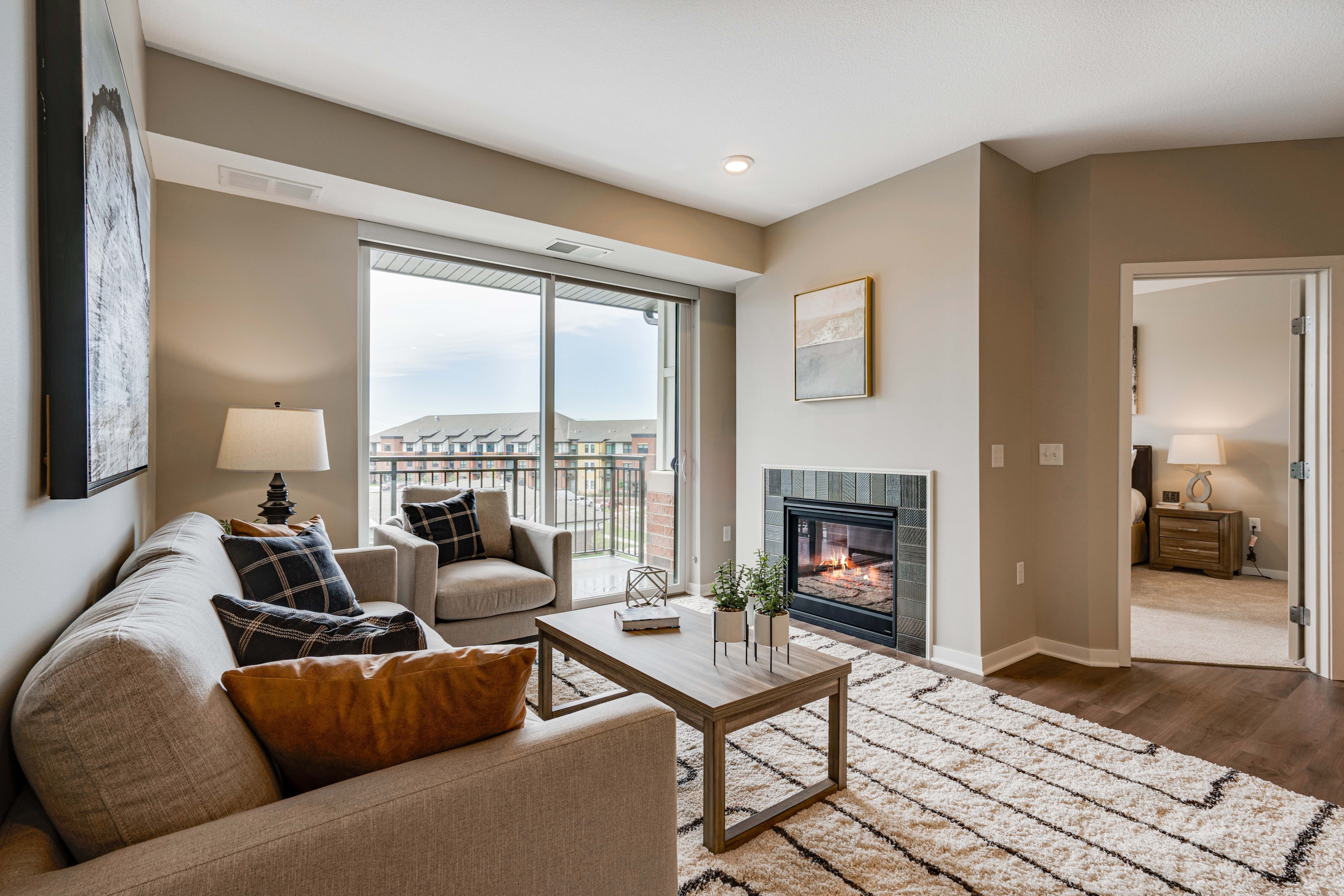 Comfortably spacious living area in a 2 bedroom apartment for rent at Ascend at Woodbury best new apartments Woodbury MN 55129