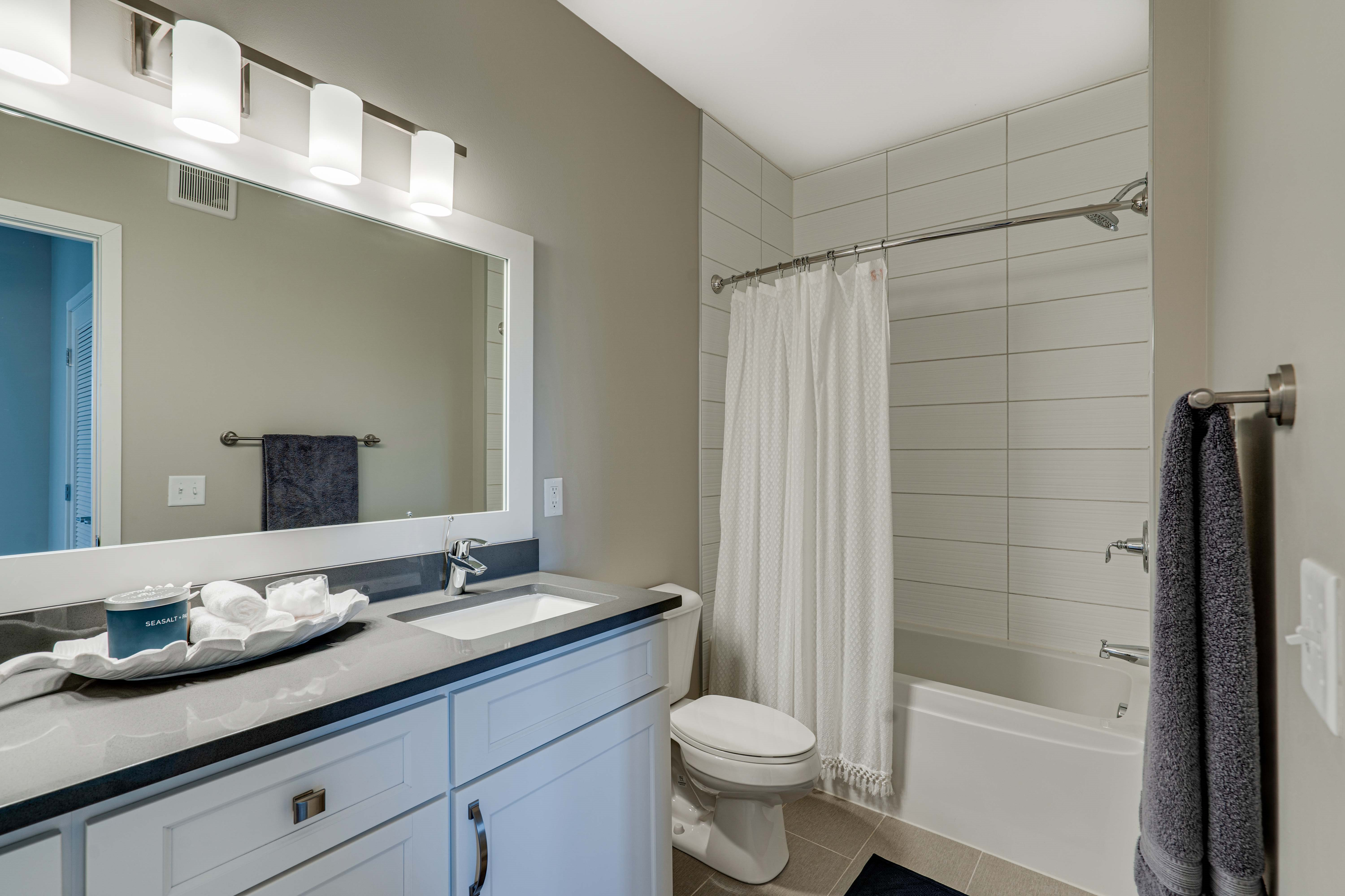 Large bathroom with tiled tub and shower surround in 2 bedroom Princeton floor plan