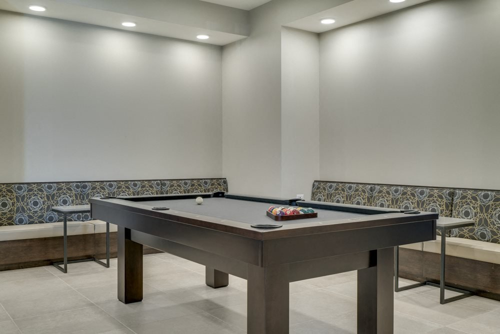 Pool table in the clubhouse's party room at Ascend at Woodbury new luxury apartments in Woodbury MN 55129