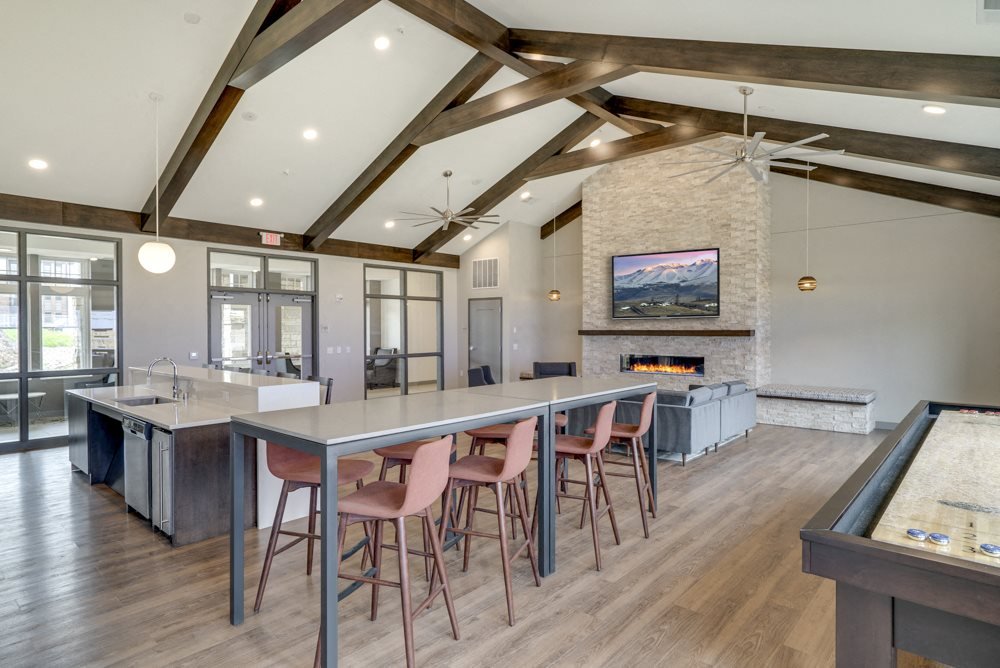 Clubhouse with seating, TV lounge and kitchen at Ascend at Woodbury MN 55129 new luxury apartments
