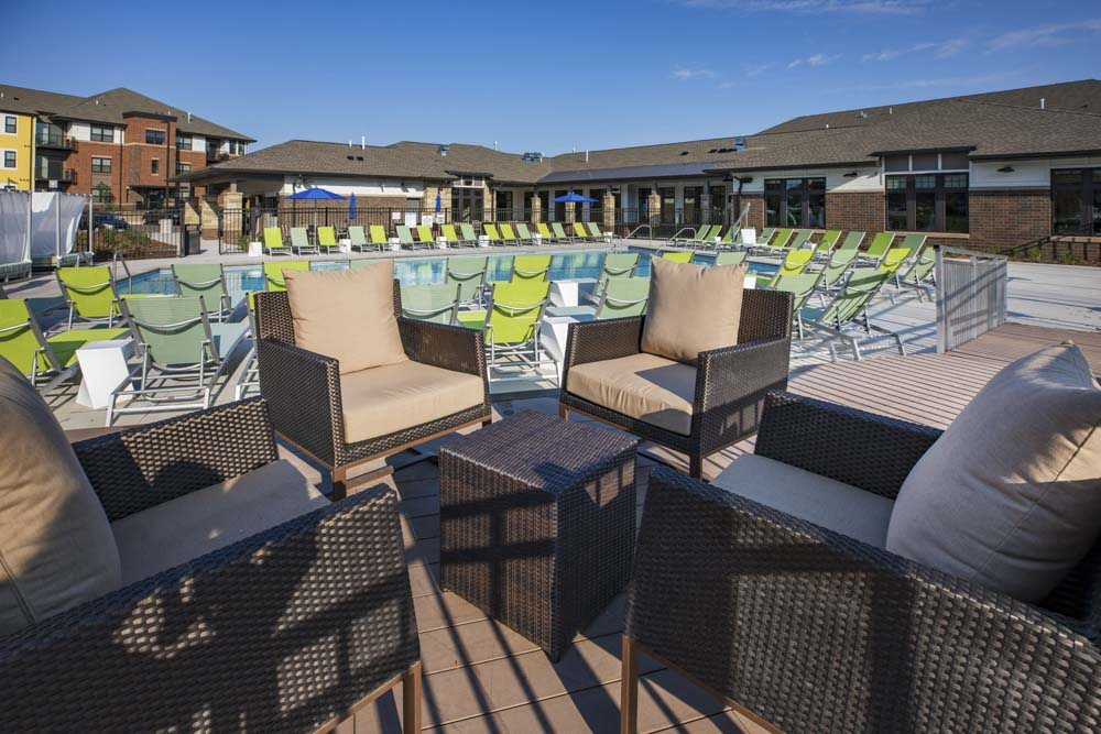 Outdoor seating by pool at Ascend at Woodbury new luxury apartments in Woodbury MN 55129