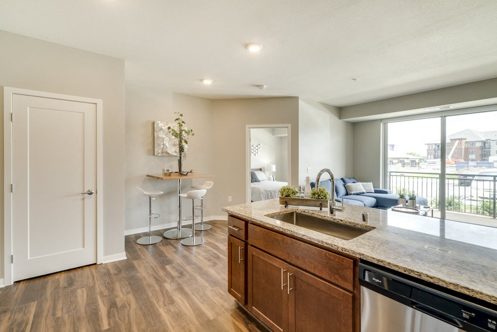 Woodland design scheme with darker cabinetry at Ascend at Woodbury new luxury apartments in Woodbury MN 55129