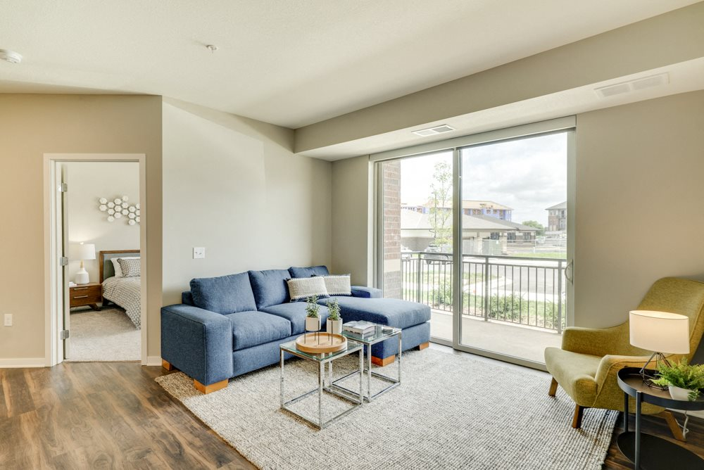 Living room in 2-bedroom apartment with hardwood-style floors and high ceilings at Ascend at Woodbury.