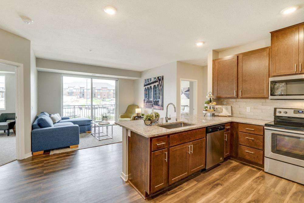 Luxury apartment with dark cabinetry and granite countertops at Ascend at Woodbury MN 55129 new luxury apartments