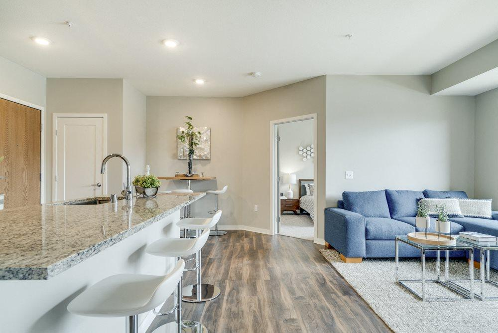 Open floor plan with kitchen, dining and living room at Ascend at Woodbury MN 55129 new luxury apartments