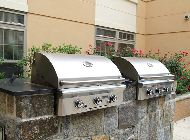 Barbecue grills in Northgate's Virginia apartments courtyard
