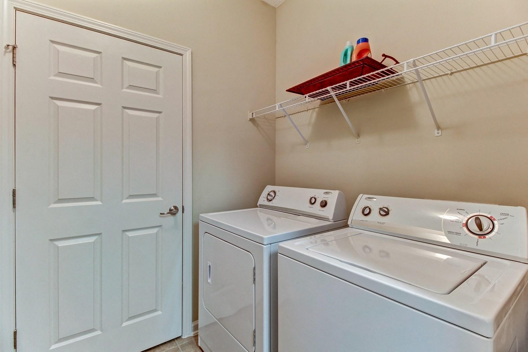 Laundry Room at Magnolia Village Apartments in Jacksonville, FL