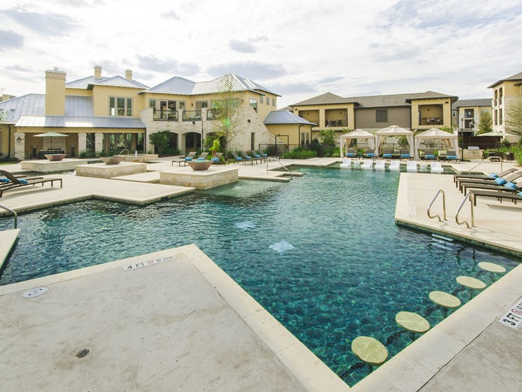 Resort inspired pool with swim up pub seating at Grand at the Dominion, Texas
