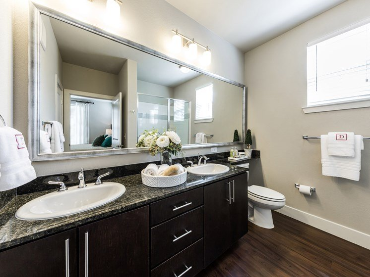 Specious Bathroom with Framed Vanity Mirrors at Grand at the Dominion, San Antonio, TX