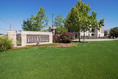 villas tech ridge sign and grass