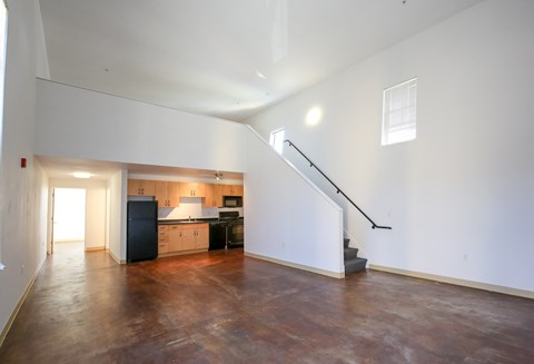 View of B2 living, kitchen and loft space unstaged