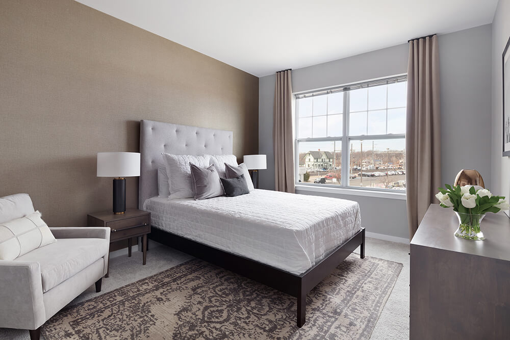 Comfortable Bedroom With Large Window at The Link at Aberdeen Station, Aberdeen, New Jersey