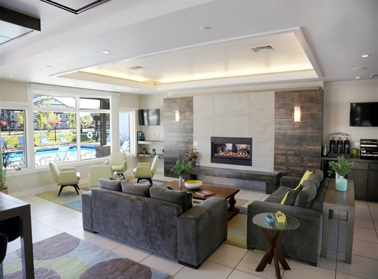 Posh Lounge Area With Fireplace In Clubhouse at Corso Apartments, Missoula