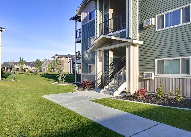 Pathway with grass to apt buildings Copper Steppe Apartments in Parker CO 80134