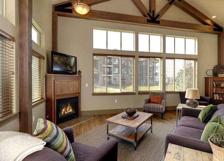 Clubhouse with seating and fireplace Parker Co Apt Rentals at Copper Steppe Apts