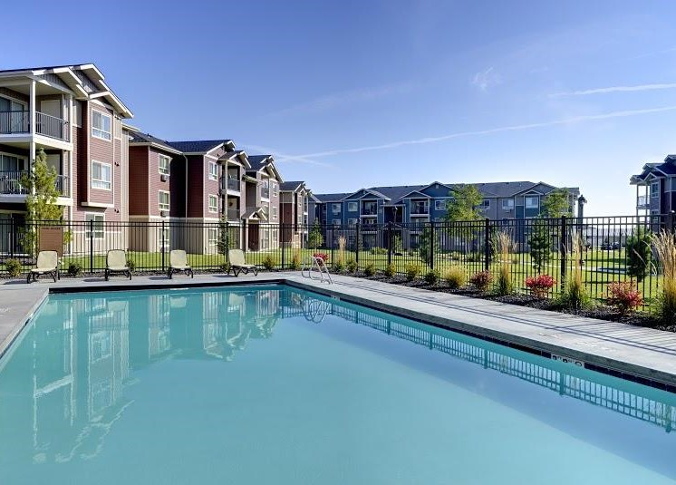 Pool with lounge chairs and apt buildings Copper Steppe Apts for rent in Parker CO