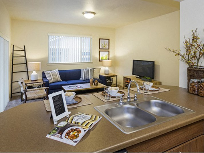 Full kitchen with living area view Parker CO Apartment Rentals at Copper Steepe