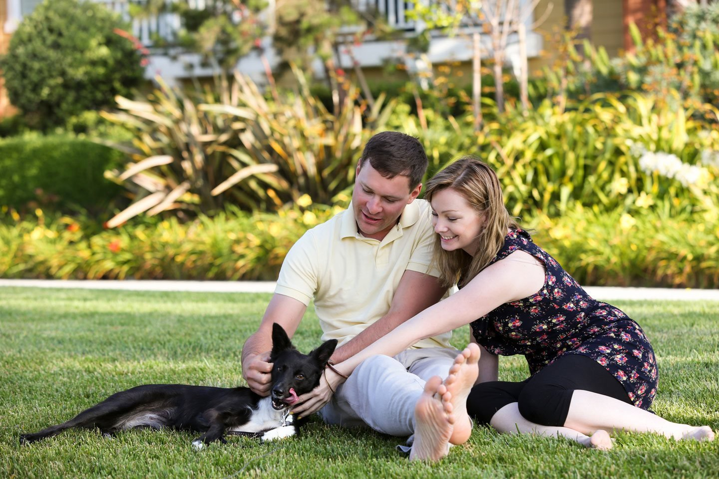 Couple in park with dog The Residence at Central Texas Marketplace l Waco, Texas Apartments