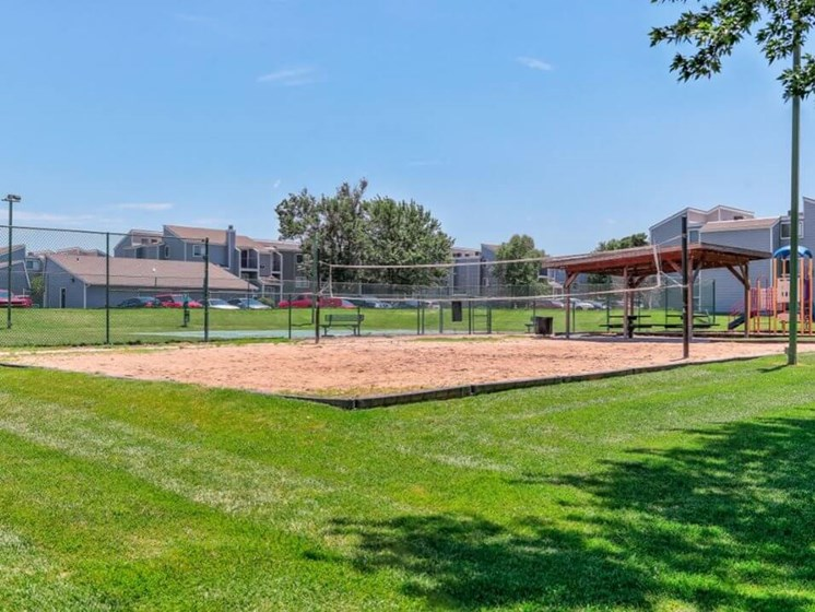sand volleyball court at Cherry Hills Apartments