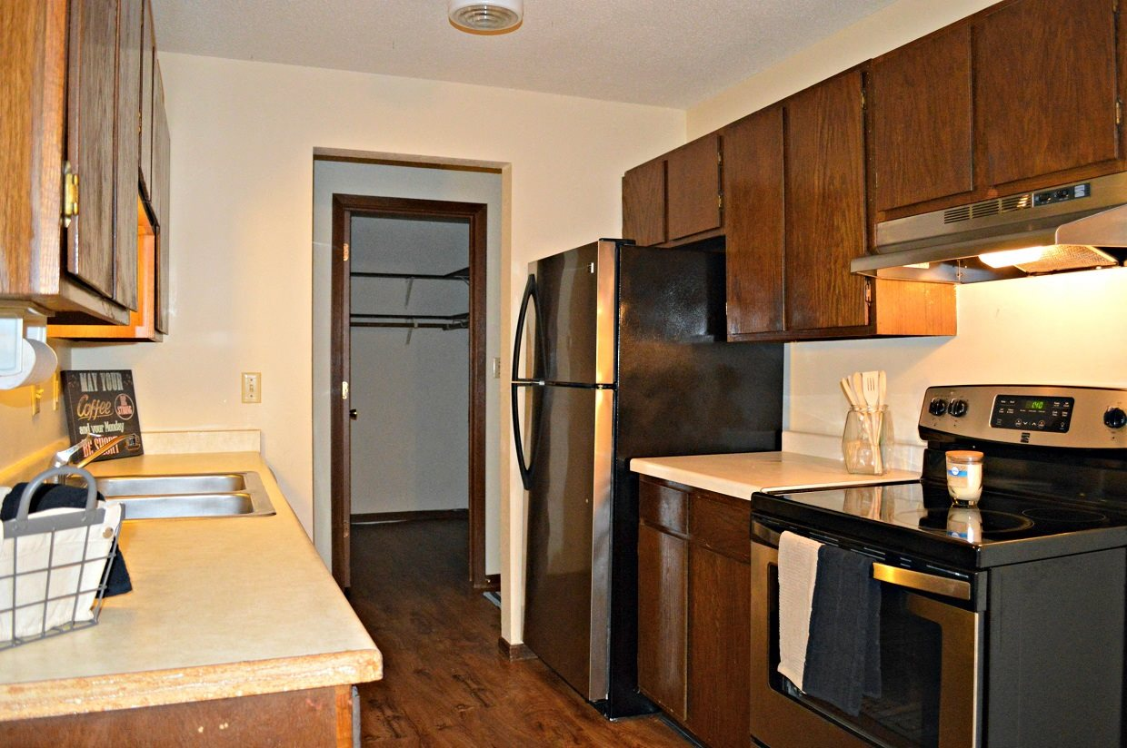 Woodland North Apartments cupboard counter kitchen space