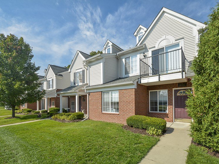 Exterior of Westbury Apartment Homes with Lush Green Grass
