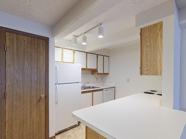 Image of kitchen with cabinets, island, and appliances