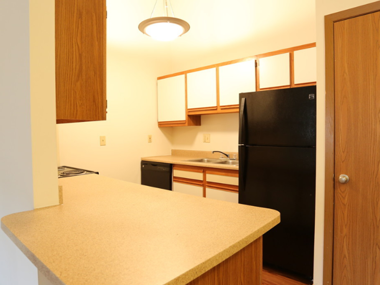 Image of a kitchen with cabinets and appliances