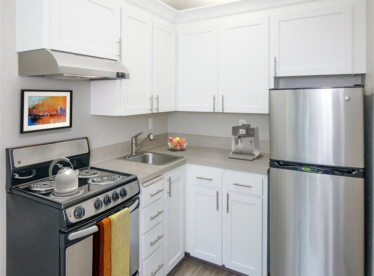 Gourmet Kitchen with White Cabinetry at Parkridge Apartments, Lake Oswego