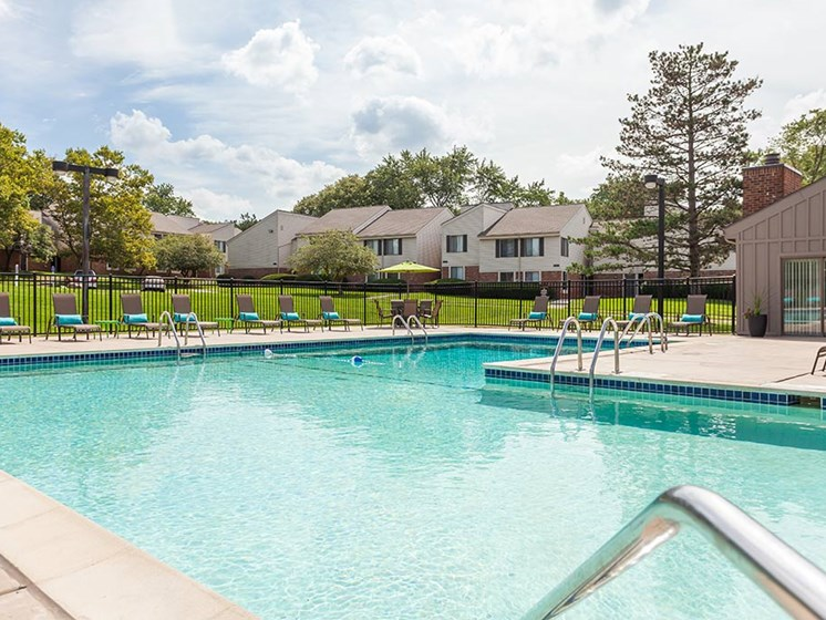 Poolside Sundeck with Relaxing Chairs, at Northville Woods, Northville Michigan