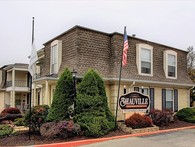 Exterior image of building with sign and flags