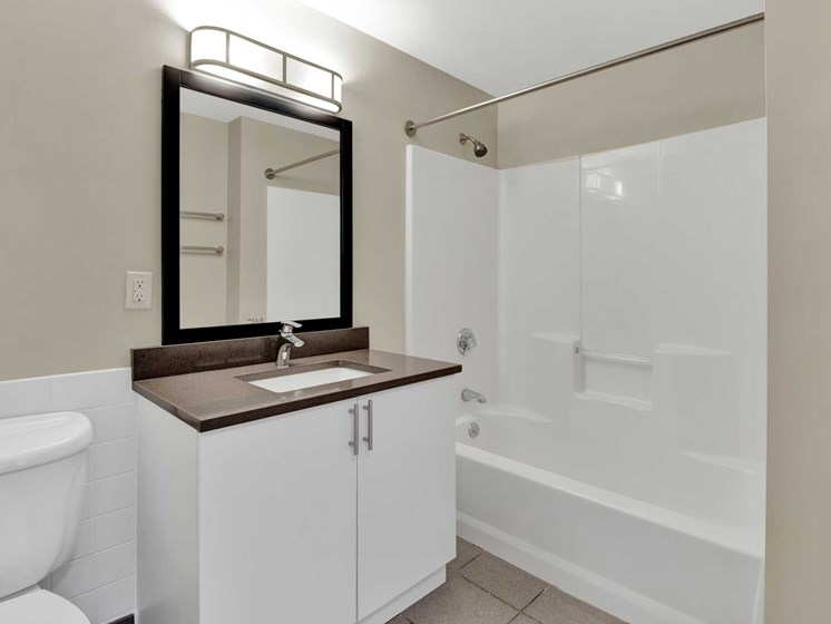 Bathroom with large shower, tile floor, modern materials and design
