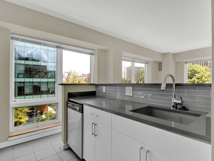 Kitchen island surrounded by windows