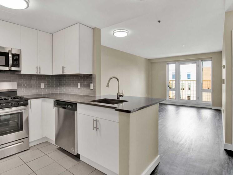 Open floor plan, modern kitchen, lots of light