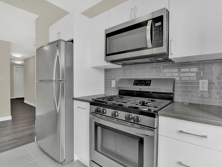 Kitchen features modern design and stainless steel appliances