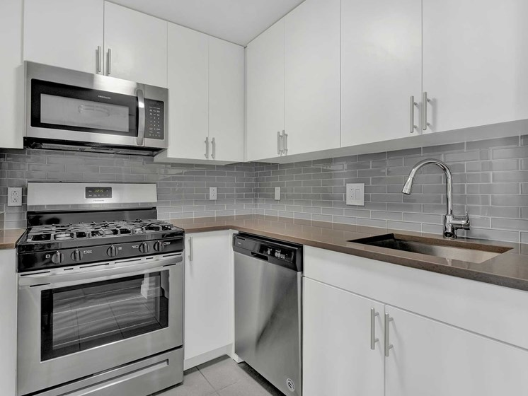 Kendall Crossing modern kitchen design with tile backsplash