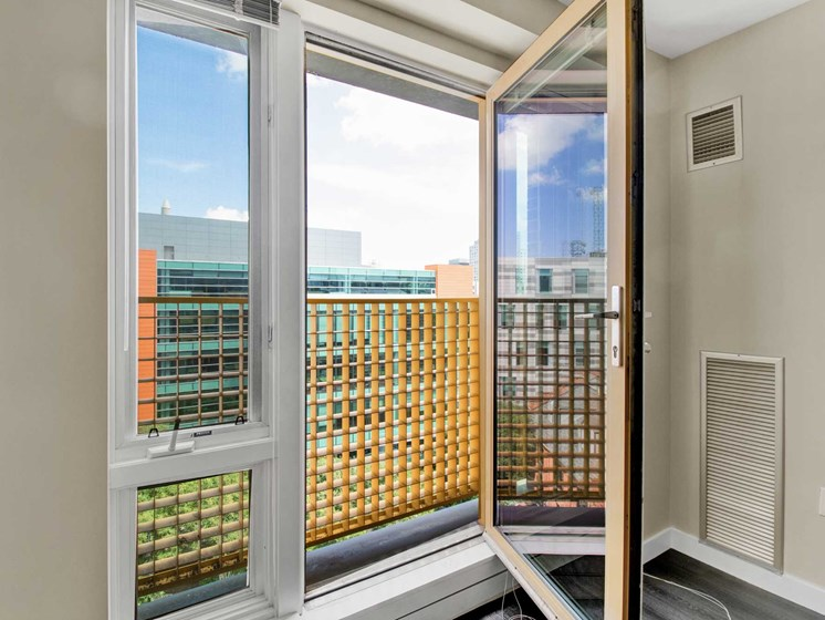 Close up of open living room window with city skyline views