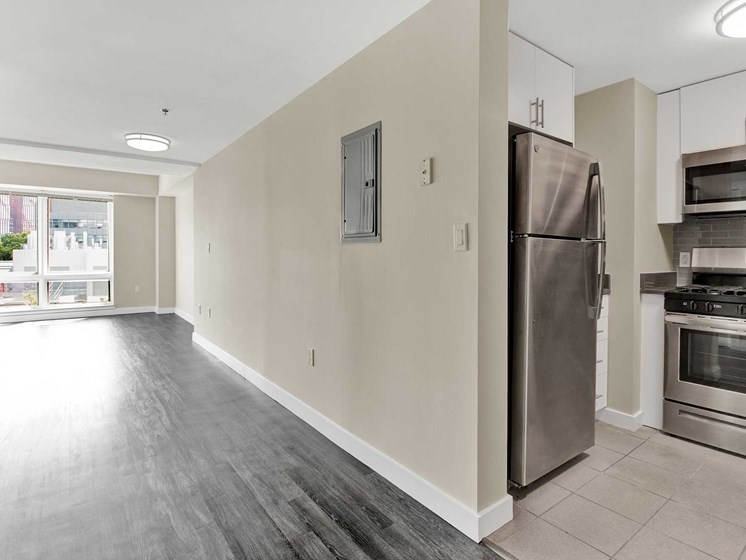 In between view of kitchen and living space