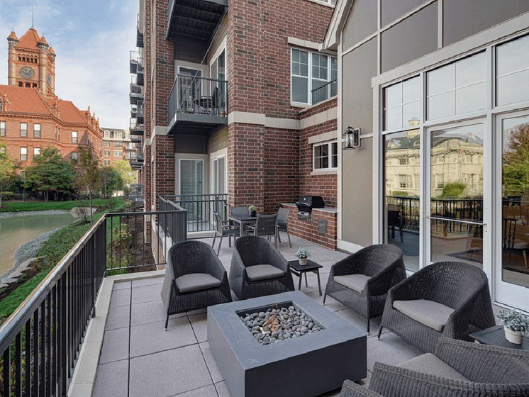 Open Air Porch with Fireplace at Courthouse Square Apartments, Wheaton, IL