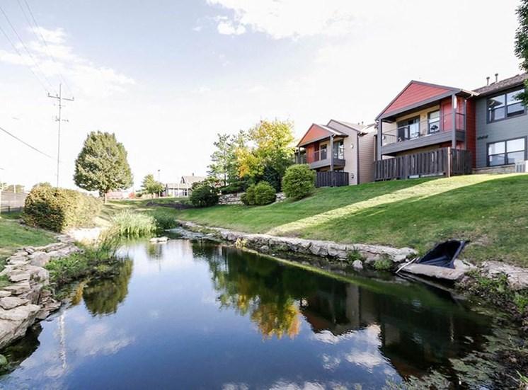 Pond behind apartments