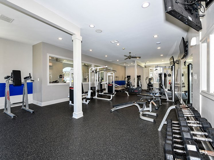 State of the Art Fitness Center featuring Wellbeats™ with Cardio and Weight Training and Flat Screen TVs at Alden Place at South Square Apartments,Durham, NC 27707