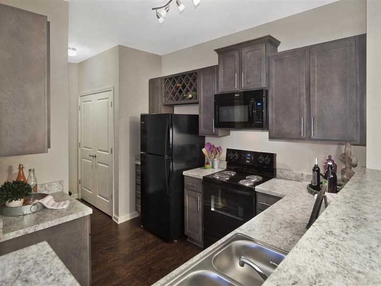 Fully Equipped Gourmet Kitchen with Built-In Wine Rack, Gorgeous Countertops and Custom Cabinetry at Ansley at Roberts Lake Apartment Homes, Arden, NC, 28704