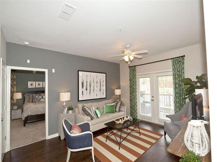 Unique Living & Dining Area with Two-Tone Paint Colors and Faux Wood Plank Flooring at Ansley at Roberts Lake Apartment Homes, Arden, NC, 28704