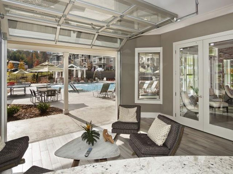 Resort Style Pool with Poolside Lounge open with Garage Style Doors and Complimentary Wi-Fi at Ansley at Roberts Lake Apartment Homes, Arden, NC, 28704